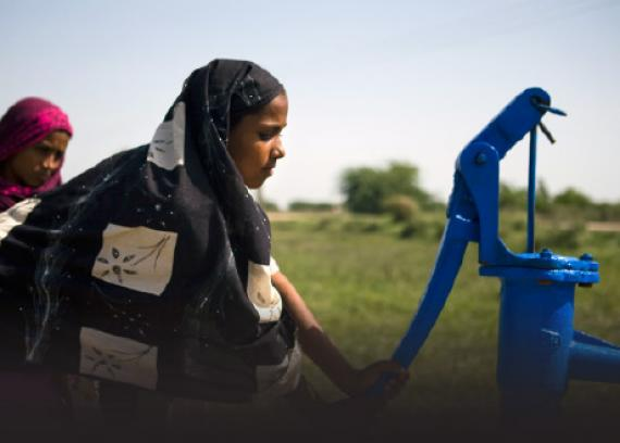 Girl pumping clean water