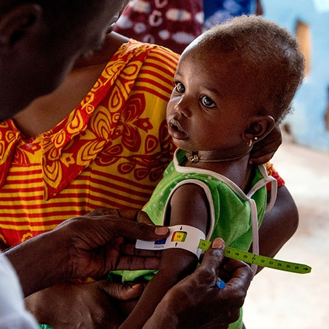 Child being tested for malnutrition