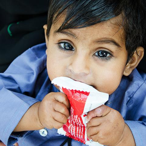 Child eating therapeutic food